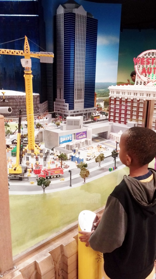 Manny enjoying the sights (and sounds!) of LEGO miniland