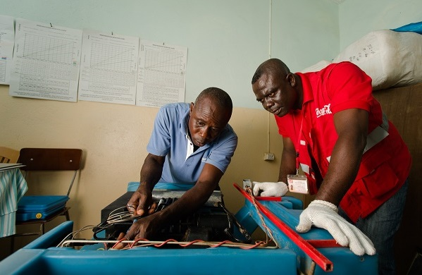 coca-cola-project-last-mile-technicians-work-on-a-cooler-used-to-store-vaccines-