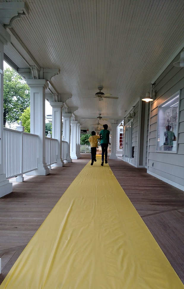 With the rain ~finally~ pausing for a minute, the kids are thrilled to be following the yellow brick road to the Wizard of Oz summer movie series at The Magic House!